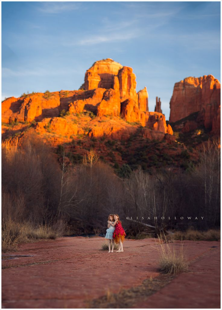 Identical twin red headed sisters standing in front of cathedral rock in sedona azlas identical twinschild photographercathedralzeldalas vegassisterslast