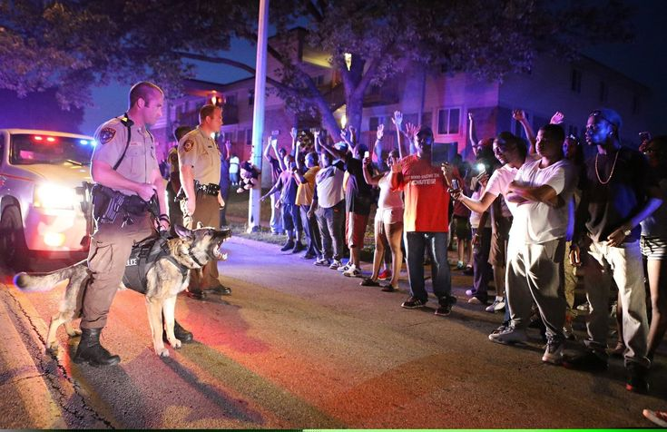 Teen shot dead by police in suburban St. Louis; residents protest