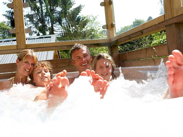Playing in the hot tub is a favourite family past-time on a Forest Holiday.