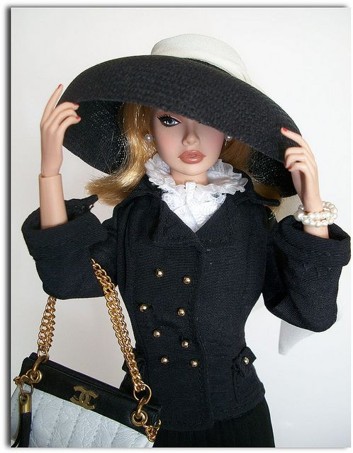 Chanel Barbie. I still love barbies!! She definitely suffers from chronic bitch face...but I do love this!