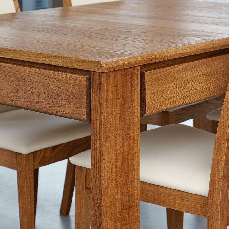 Popular Olten Extending Dining Table with drawer in Oak Finish