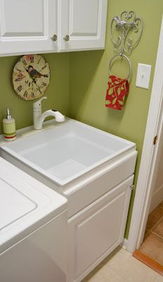 close-out base cabinet purchased at Lowe's with a laundry sink dropped in...love the decorative towel holder...