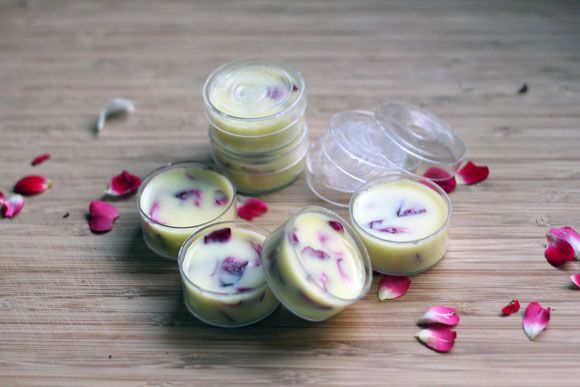 Homemade Lip Balm: 1/8 cup Coconut Oil (available at most grocery stores or health food stores) 1/4 cup Beeswax (available at craft stores) 1/8 cup Shea Butter (available at craft stores or health food stores) 1 tsp Coconut or Vanilla Extract 1/4 cup Rose Petals (fresh or dried), feel free to substitute a different flower or herb here 1 tsp Sweet Almond Oil (available at craft stores)