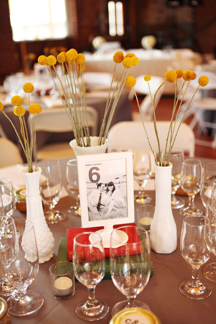 simple center pieces. i especially love how they did their table numbers!
