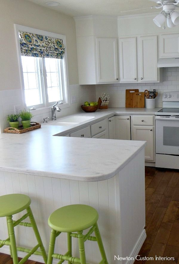 Our White Kitchen Reveal from NewtonCustomInteriors.com.  Check out how our kitchen was updated.  No more 90's orange oak!
