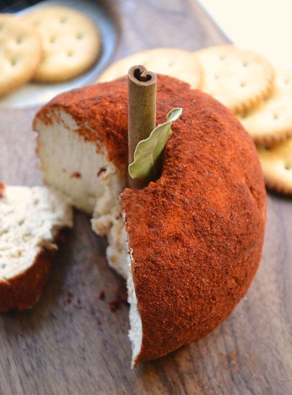 Spiced Apple Cheese Ball-2 cups grated white Cheddar or Gouda 1 8 oz (250 g) package cream cheese, softened 1 tsp. garlic powder pinch red pepper flakes paprika half a cinnamon stick 1 bay leaf