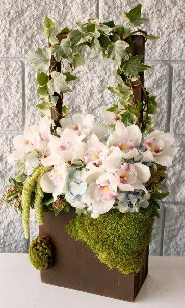 Dozens of white Orchids carefully arranged in a unique, moss-covered wooden box from Pasadena Florist. This calming design makes a perfect addition to any room and it is an excellent gift for Birthdays, graduations and other major celebrations.Pasadena Florist is your best local, online florist for Pasadena and the surrounding areas. Order flowers online from Pasadena Florist for same day local flower delivery from conveniently located shops in Southern California to send flowers to Los…