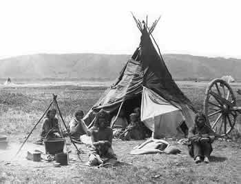 An Assiniboine lodge photographed by W.E. Hook, Sr., in the Cypress Hills in 1878-1879.