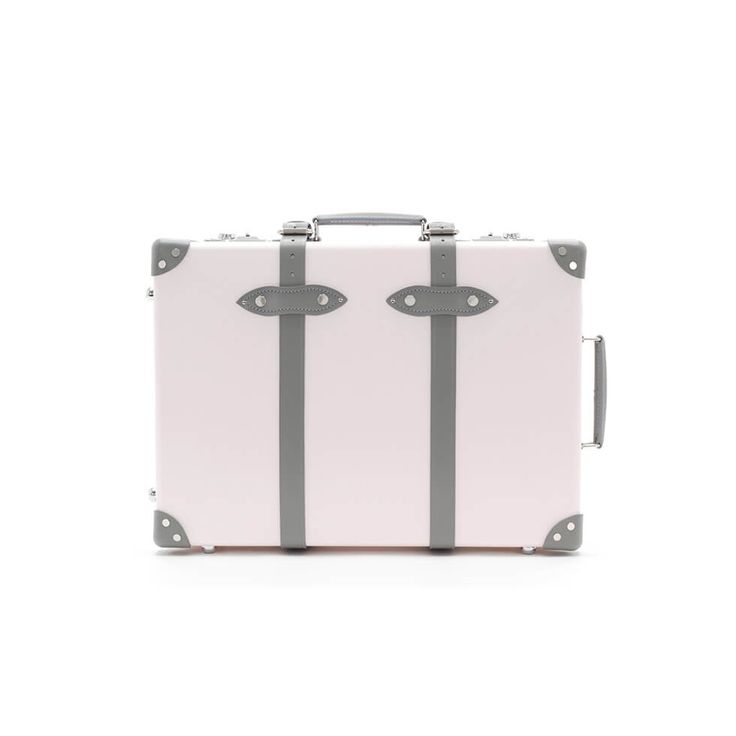 """Inspired by the English country garden and the Arts and Crafts Movement of the late Victorian era, the new Globe-Trotter 'Emilia' collection features a range of special edition cases in light pink with grey details and a subtle floral lining.The new 20"""" size is a revision of the previous 21"""" trolley case. It has been developed to new dimensions in line with the International Air Transport Association's (IATA) regulations to ensure it can be classed as hand luggage on the majority of…"""