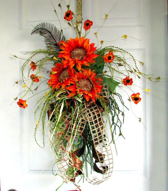 Fall wreath, autumn wreath, Fall door bouquet, designer wreaths, fall decor, Thanksgiving decor, fall swag, floral door swag, sunflowers **3 to 5 bus. days until ship. ->>>SORRY, ONLY ONE AVAILABLE!<<< Even though there are 2 listings in my shop, its the same swag. Sorry! Greet all your guest with this unique Fall display to hang on your door. I gathered together 3 of the most gorgeous artificial orange sunflowers, with sparkling glittering gold centers (with stems). To wh...