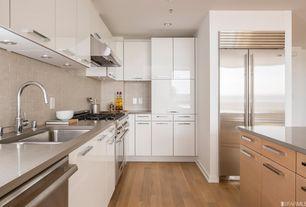 Modern Kitchen with High ceiling, Limestone Tile, L-shaped, Bellmont Cabinets- Euro, Flush, Hardwood floors, Stone Tile