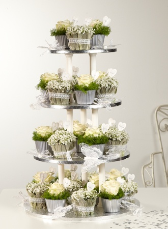 interesting concept -- stacked small arrangements --Favourite Favours | http://souk.oasisfloral.com