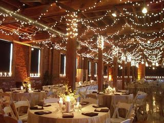 "For anyone who is getting married in an indoor venue who (like me) steers away from a traditional look - I don't think there is anything better than giving an indoor wedding that ""outdoors - under the trees type"" romantic feel. It's pretty simple to do. Low-hanging string lights, candles (I prefer mason jars with votive candles) and low minimalist flower centerpieces."