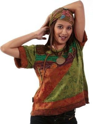 Hippie-chic multi coloured summer top combine's embroidered mushrooms, cutwork and funky applique. This viby bohemian Nepalese look is ethnic but chic. The mushroom designs make it a must for any full moon party. Exclusive to retailers who are looking for something unusual for their customers. #hippieclothes #bohemiantops #hippyclothing
