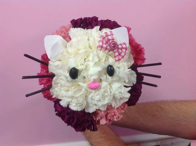 We are a full service floral shop in Florida. We made this Hello Kitty flower arrangement for a little girl's dance recital. I love how it came out and the bright colors. We can make this for your special day.  Please stop in and visit us or at ChloesCreationsFl... Facebook: www.Facebook.com/chloescreationsflorist