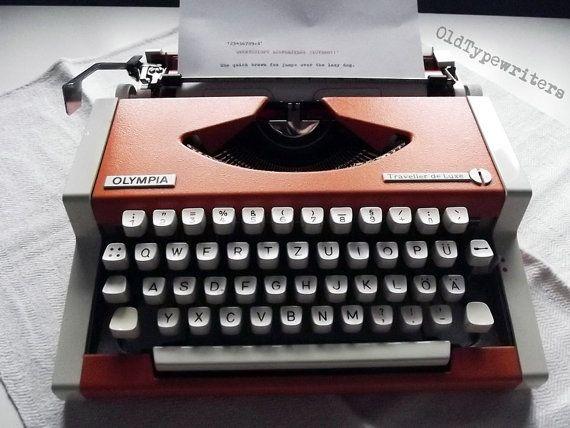 Great Vintage Orange Manual Typewriter Olympia by OldTypewriters