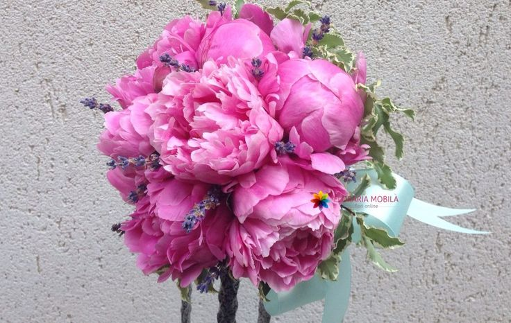 The bouquet is made of pink peonies , lavender , green and accessories.