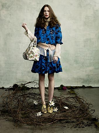 a woman models a floral dress from Chicago's Nordstrom store