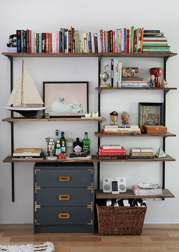 I love all the little knick knacks on this DIY shelving system. The boat! And the painting! Too cute.