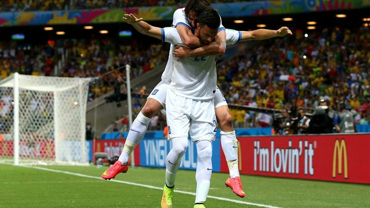 Andreas Samaris (front) of Greece celebrates scoring his team's first goal with his teammate Giorgos Samaras