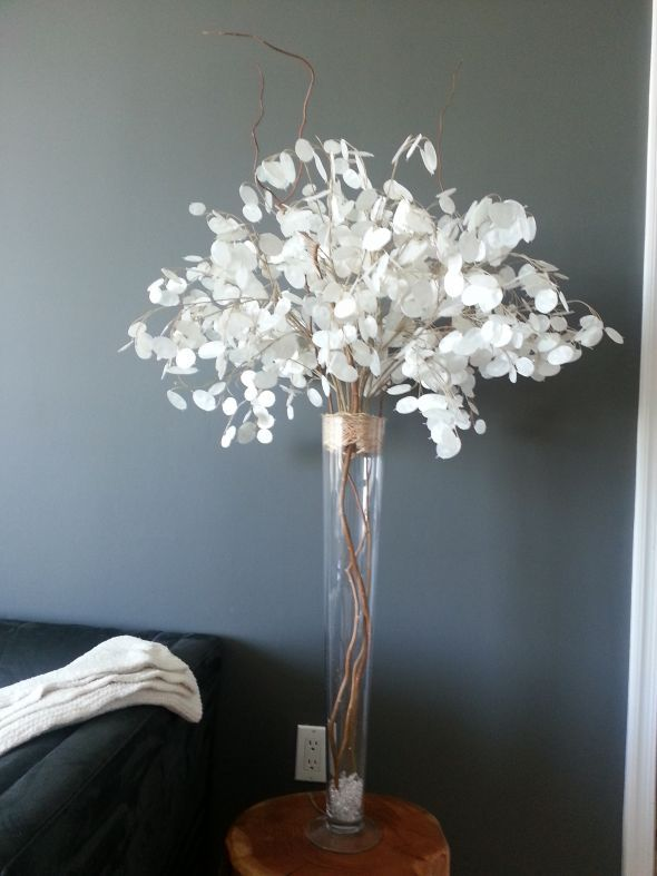 I've opted to make my own centerpieces using non floral options.  After purchasing silver dollar sprays, some curly willows, a tall vase, acrylic ice, and some straw, here's what I can up with.    Read more: http://boards.weddingbee.com/topic/diy-silver-dollar-centerpieces-thoughts#ixzz2p6CDDAgE