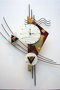 modern wall sculptured clock