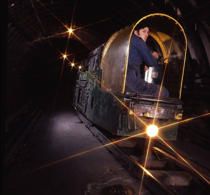 An engineer travels through the tunnels of the Post Office (London) Railway/Mail Rail on a battery powered engineering locomotive between West Central District Office and the Western District Office, 1971.