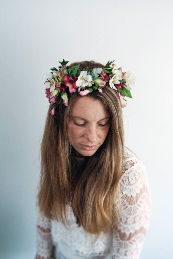 This gorgeous tropical flower crown is the perfect bridal hair accessory for a summer wedding. Would be great for a bridesmaid of flower girl too! Made from the highest quality silk geraniums in cerise pink with hanging buds. Stunning freesias, and mixed ivory blooms. A gorgeous mix of greenery finishes the piece.  All is attached to a rustic covered wire halo, and fastened with a metallic silver ribbon.  One size fits all.  This is truly a stunning piece.  Multiples can be made by special…