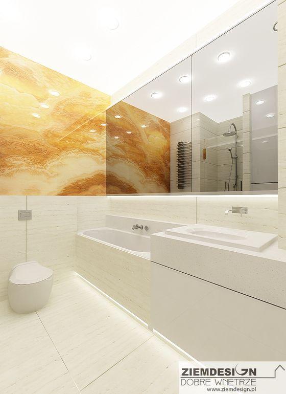 Łazienka z fragmentem kamiennym - onyx oraz szerokim lustrem i ukrytą szafką za nim