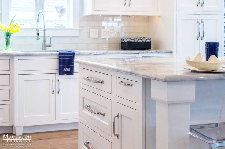 Don't you need this gorgeous White Kitchen in your Avalon Beach house? Visit #MacLaren today! 610-436-5436 Www.maclarenfab.com #beachhouse #beachhousekitchen #WhiteFantasy #Marble #sink #bumpout #whitekitchen #whitecabinetry #SquareInsetCabinetry #WhitePaint #DecorativeHardware #Amerock #PolishedNickel #avalon #stoneharbor #2mileisland #luxurykitchens #marblecountertops #islandseating