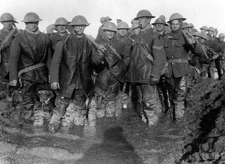 British soldiers standing in the mud on the French front, ca. 1917.