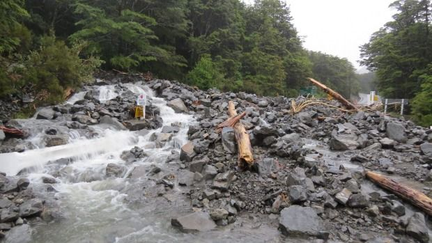 Wardens Creek near Arthur's Pass village has blown out, dumping boulders and debris across the State Highway.