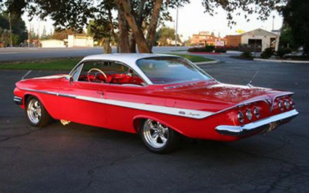 1961 Impala SS 409, the first year of the Super Sport option.  In '61, you could add the SS option to any body style, altho it was rarely done.  In '62 and later the SS was only available in the 2 dr Impala hardtop.