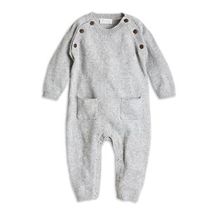 The soft fine knit organic cotton blend make this monochrome onesie feel super comfy to your baby's skin. With subtle detailing like tiny contrasting buttons and a cute appliqué, this piece is truly made with all our love.