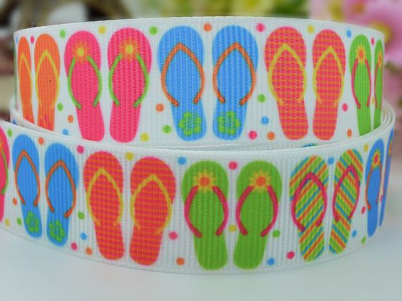 Delightful 100% polyester grosgrain ribbon with bright multi coloured flip flops on a white background with small colourful spots.  This beautiful multi coloured flip flop grosgrain ribbon is a summer craft essential with its pretty little flip flops on a white background with tiny coloured spots. It would be ideal for a cake decoration for a summer themed cake or to jazz up your summer clothes. Its very versitile and could also be used for hair,scrap booking,trimmings,gift wrapping and…
