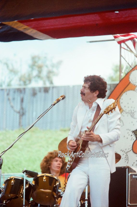 WOW, Check it out......Its a rare CARLOS SANTANA Concert PHOTO from Bill Grahams DAY ON THE GREEN ROCK CONCERT SERIES in OAKLAND California. The photo is a 8 x 10 quality print from 35mm film shot at the concert on July 26,1978. Ships flat. If youre a SANTANA fan or a collector