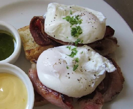 Bacon & Eggs with a side of hollandaise and basil pesto - one of our most popular breakfasts