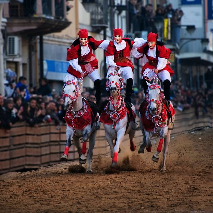 Red & White Balancing Act - Carnevale della Sardegna. Oristano, island of Sardinia, Italy by Tati@, via Flickr