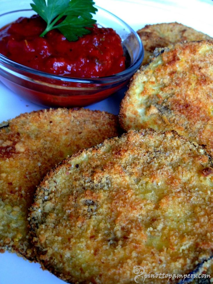 Eggplant Parmesan 1 medium eggplant, cut into 1/4 – 1/2 inch slices 1 egg white, beaten lightly 1/2 cup of breadcrumbs (Italian seasoned crumbs work beautifully) 1/4 cup grated Parmesan cheese 1 tsp Italian spices garlic salt and ground pepper to taste 12-15 min. 400F