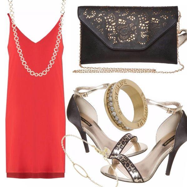 Il vestito rosso è un classico per eccellenza, sensuale eindicato per la sera in combinazione con il nero e l'oro per un colpo a botta sicura. L'enveloppe bag è elegante mentre i sandali con dettaglio leopardato danno voce al vostro lato wild.