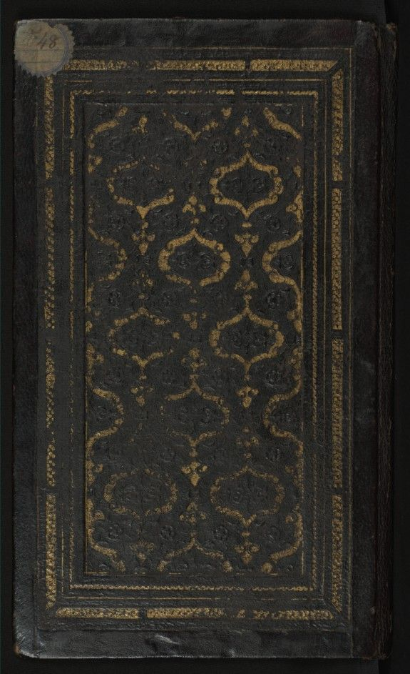 Binding from Mihr and Mushtari.  This original binding from Walters manuscript W.627 is composed of black leather and has a flap. The binding has a gold-brushed central panel and doublures of red leather with filigree work.