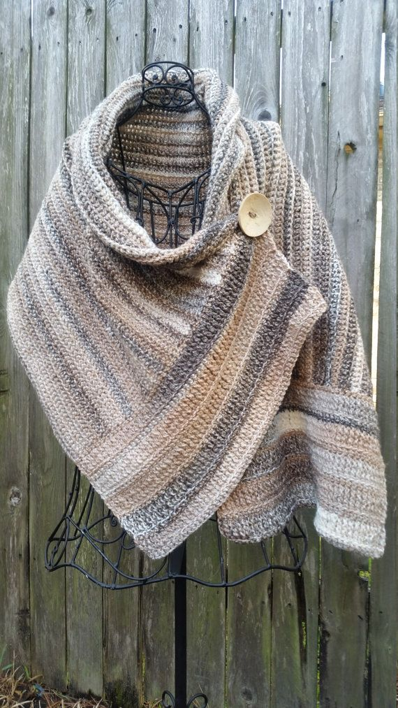 """Crocheted buttoned wrap measures 63""""x18"""" & fits med-XL, depending on where it is buttoned. When worn, wrap falls to mid-back ,points in front fall to just below the waist, & comes down to just past the elbow. Yarn used is a very soft acrylic."""
