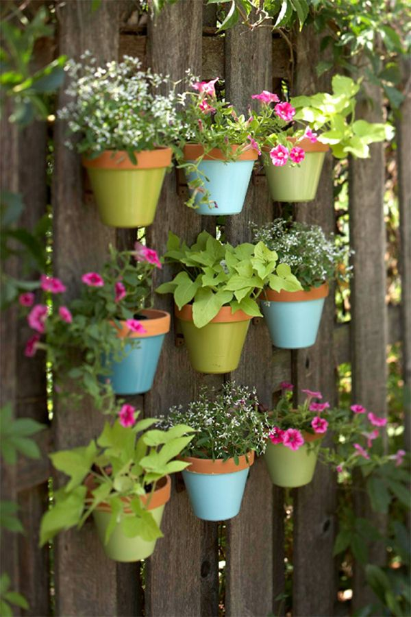 DIY Painted Pots Fence Garden - paint bottoms  of pots, hang on fence using pot hangers