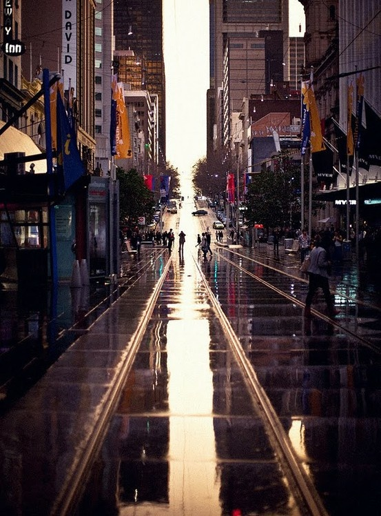 A great shot of Collins Street, Melbourne. Following the vertical lines as the composition is a great way to do street photography.