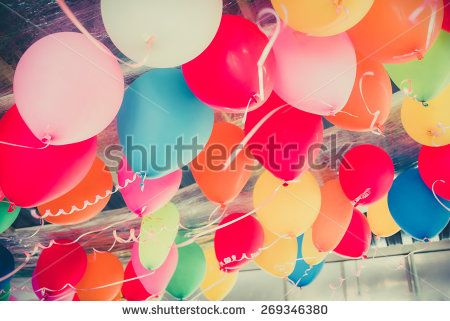 Colorful balloons floating on the ceiling of a party in vintage childhood memory color style for festival like birthday or christmas celebration party - stock photo