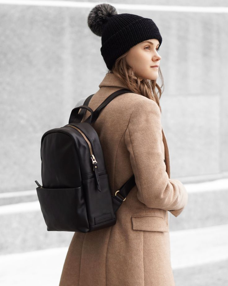 A Little Detail - Black Bobble Hat // Camel Coat // Black Leather Backpack //  #outfit #winterfashion #backpack #streetstyle #womensfashion #outfit #camelcoat #bobblehat #beanie