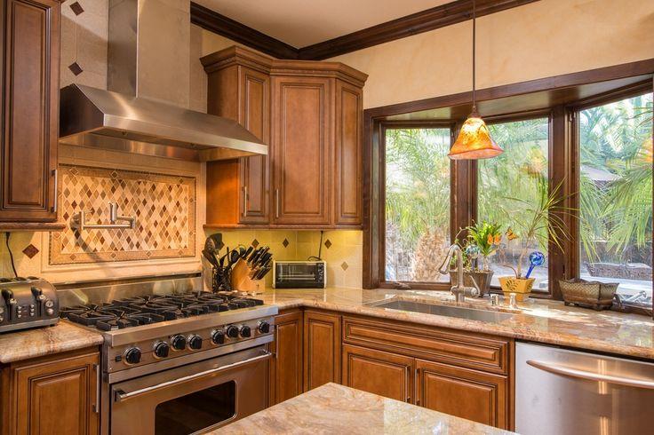 Craftsman Kitchen with Black & Decker 4 Slice Toaster, Stone Tile, Raised panel, Garden window, Kitchen island, Crown molding