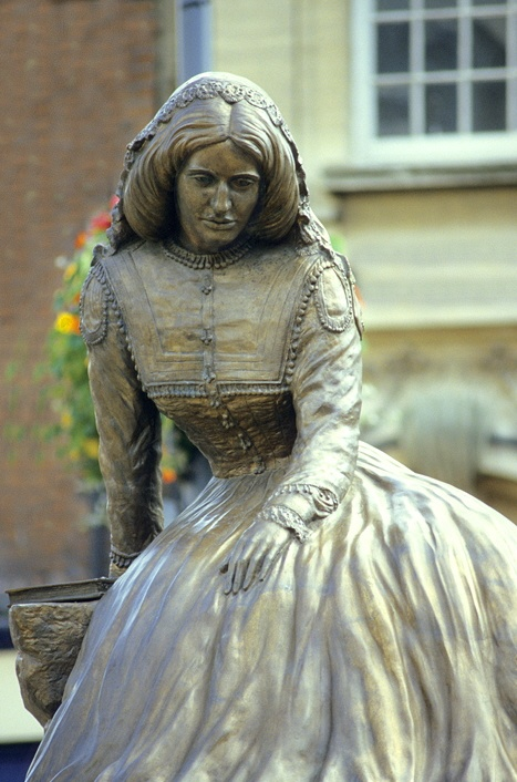 NUNEATON, ENGLAND  -  George Eliot statue in the Nuneaton town square.  - It is never too late to be what you might have been - George Eliot Secular Humanist