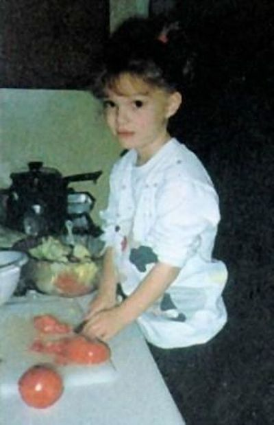 Little Natalie Portman, helping prepare dinner. So cute!