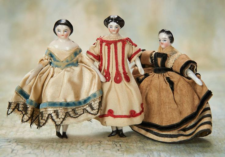 """German Porcelain Dolls in Original Costumes - 3 1/2"""" (9 cm.) Each has porcelain shoulder head with black sculpted hair,painted facial features,muslin body,porcelain lower limbs. Condition: generally excellent. Comments: Germany,circa 1875."""